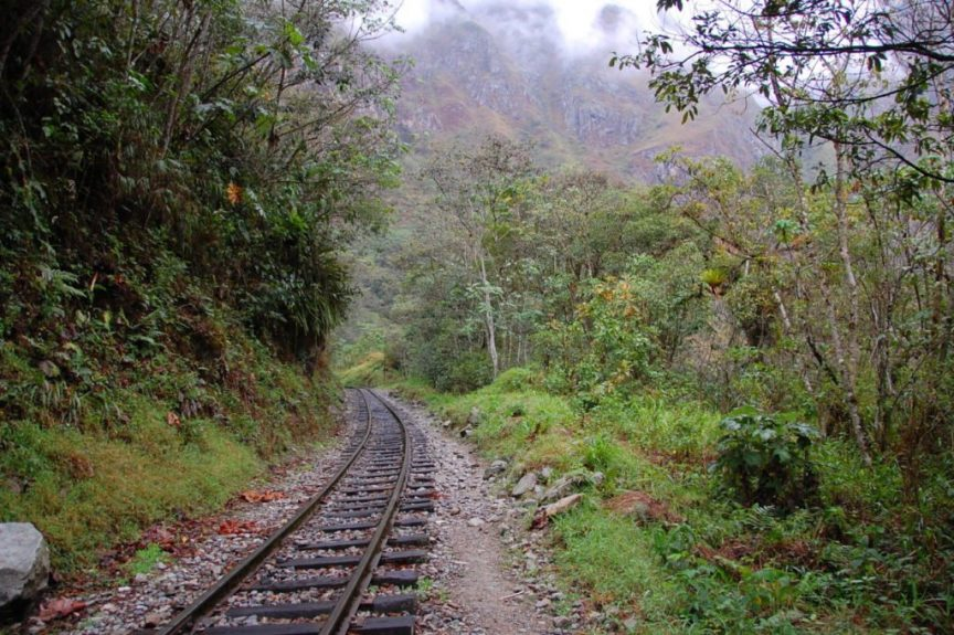 Backpacking travel on train tracks in the Andes