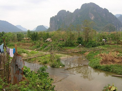 Bridge over muddy water in Vang Vieng, Laos