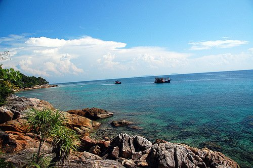 Boats and blue water at Coral Bay in Perhentian Kecil, Malaysia