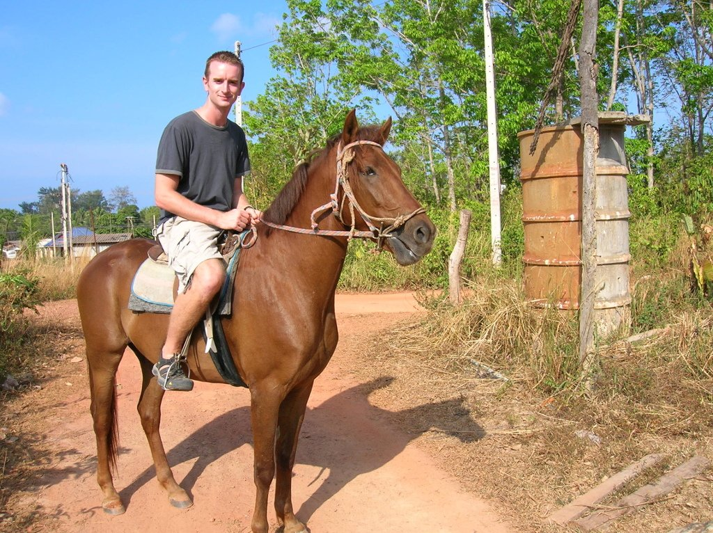 Greg Rodgers on a horse in Thailand