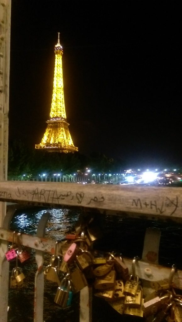 Eiffel Tower at night and Padlock Bridge in Paris